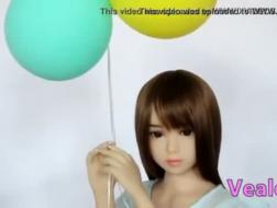 A sweet asian doing a dildo