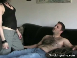 Beautiful MILF smoking a cigarette and sucking a stiff cock