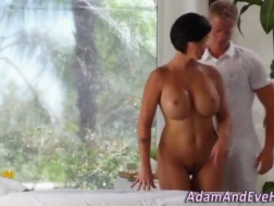 Gorgeous brunette MILF bends over so a black stud can slam her down on his massage table